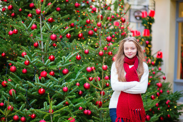 Girl with decorated Christmas tree