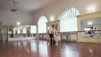 Pas de deux, female male ballet dancers taking steps together