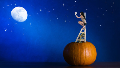 Girl climbing on a  ladder and a  pumpkin launches  airplanes