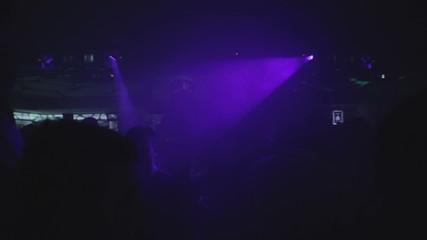 Dark dance hall in the night club, clubbers enjoying nightlife
