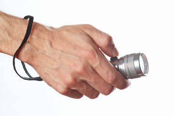 Hand holding a torch on a white background