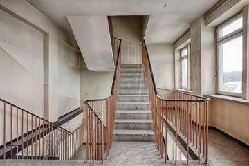 Staircase in an abandoned and forgotten building