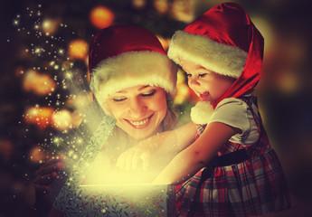 Christmas magic gift box and  happy family