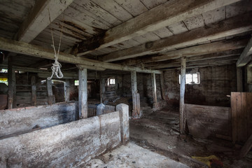 Interior of an old, decaying barn