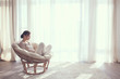 Woman relaxing in chair - 72130247