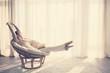 Leinwanddruck Bild - Woman relaxing in chair