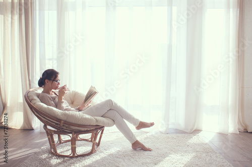 Woman relaxing in chair - 72130274