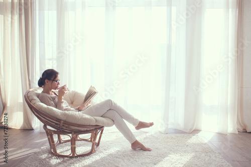 Leinwanddruck Bild Woman relaxing in chair