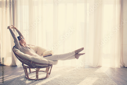 Woman relaxing in chair - 72130286