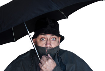 scared man under umbrella