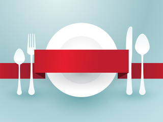 cutlery with ribbon over plate