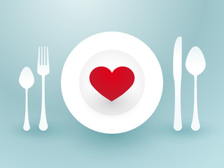 fork knife and a red heart on a plate
