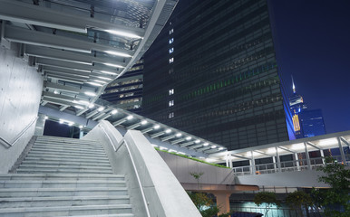 Staircase in city at night