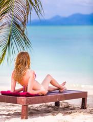 Attractive woman enjoying at the sun