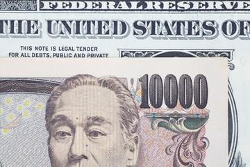 Close - up Japanese bank note and dollar bank note