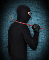 mugger in mask with nail puller