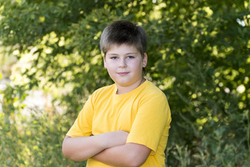 Portrait of 10-year-old boy in  park