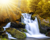 Fototapety Autumnal landscape with waterfall