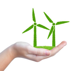 Green wind turbines symbol in hand