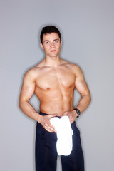 Shirtless male model on gray background