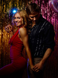 Young Couple Dancing In Disco