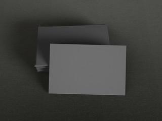 Black business cards on dark background