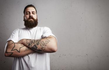 Portrait of a tattooed bearded man