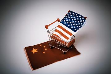 Shopping cart with USA flag on China flag
