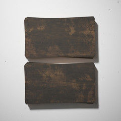 Dark wood business cards on white concrete
