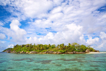 Tropical island with palms and sand beach, Seychelles