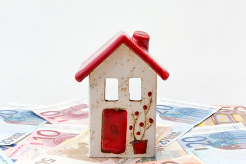 Red and white house with Euro notes