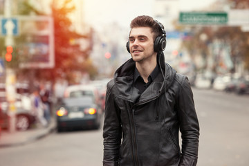 man in headphones on the street. Listening to music