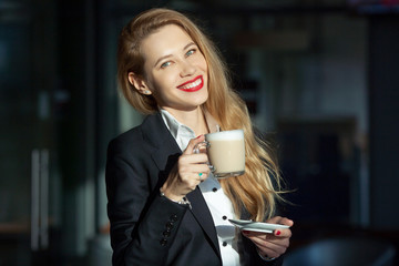 portrait of a beautiful woman with a cup of cappuccino