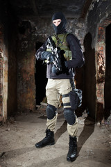 Special forces operator during night CQB mission