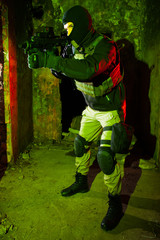 Special forces soldier during night CQB mission
