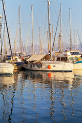 Yachts in Marina of Agios Nikolaos in evening. Crete, Greece