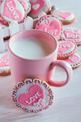 pink cup with milk and homemade cookies