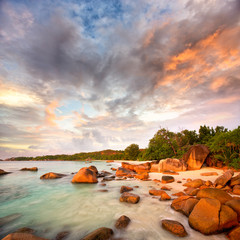 Granite rocks at Anse Lazio beach at sunset, Praslin, Seyshelles