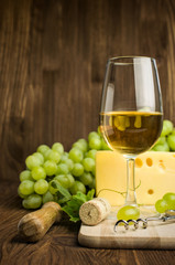 white wine with cheese and grapes