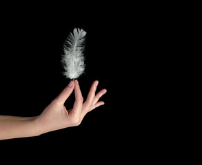Close up of white feather in hand