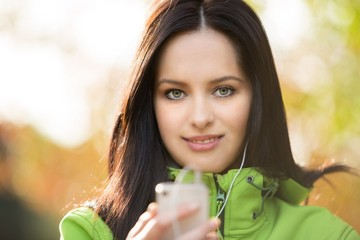 Young woman listening to music.