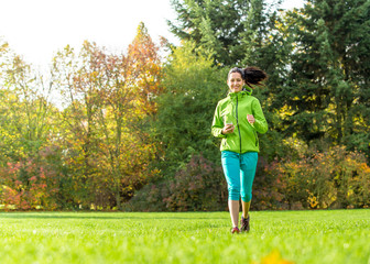 Young woman running and listening to music.