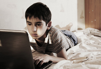 boy and home computer