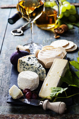 Various types of cheese and white wine
