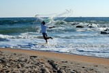 Man with bait casting net