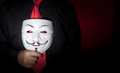 Anonymous mask and red neck tie