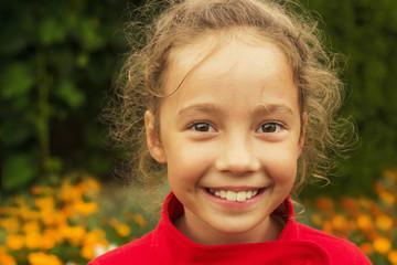 Happy cute little girl having fun at sunny day