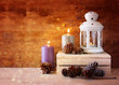 White vintage Lantern with burning candles, pine cones on wooden