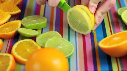 Chopping fruit in colorful kitchen scene