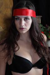 Woman, beautiful sensual look in headband and bra